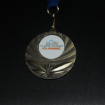 The finisher's medal with the logo I designed